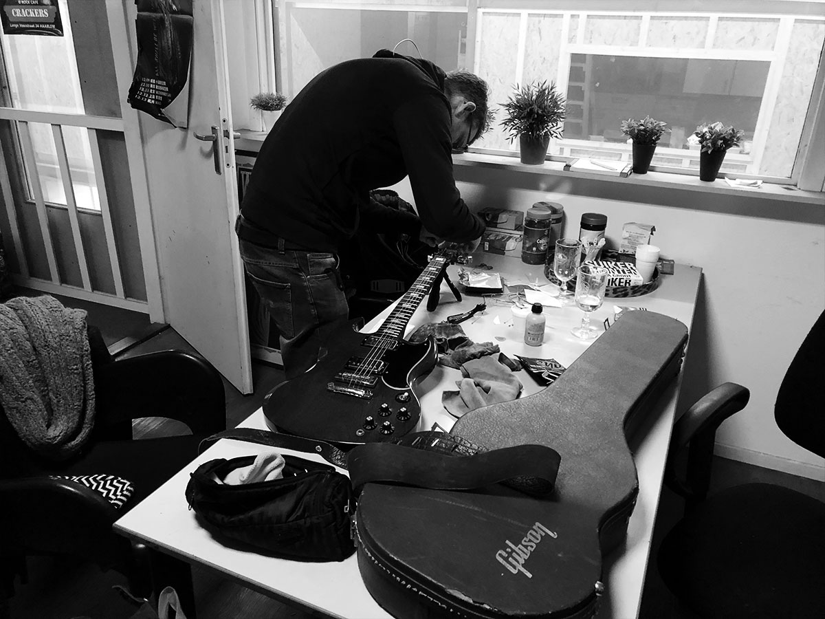 Niels making sure our guitars are in top shape. Pretty handy having a former guitar tech in the band.
